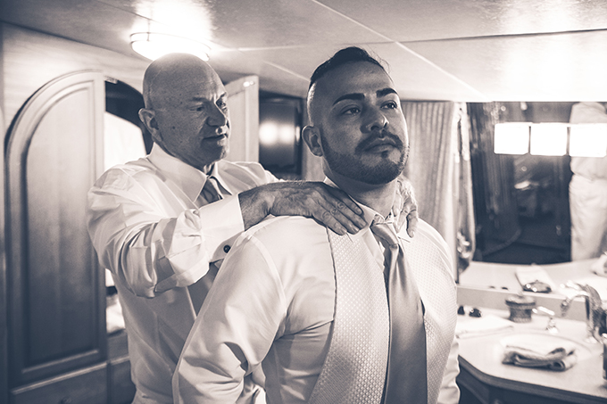Two Grooms getting ready for wedding ceremony - Charter Yachts of Newport Beach