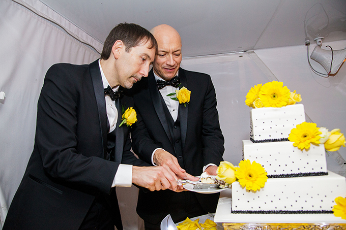 LGBT couple cutting their wedding cake - Charter Yachts of Newport Beach