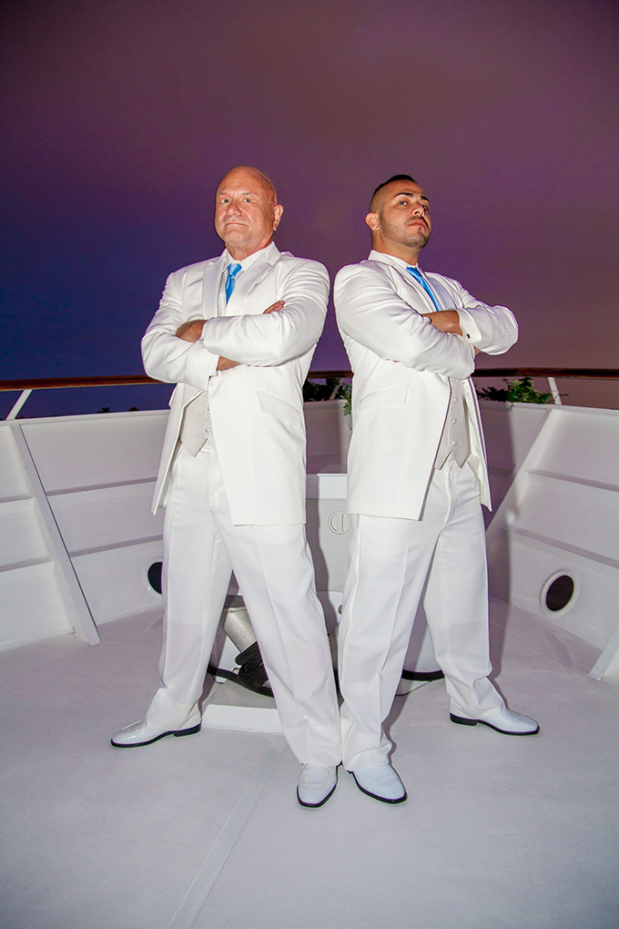 Two Grooms getting ready to say I do on a yacht - Charter Yachts of Newport Beach