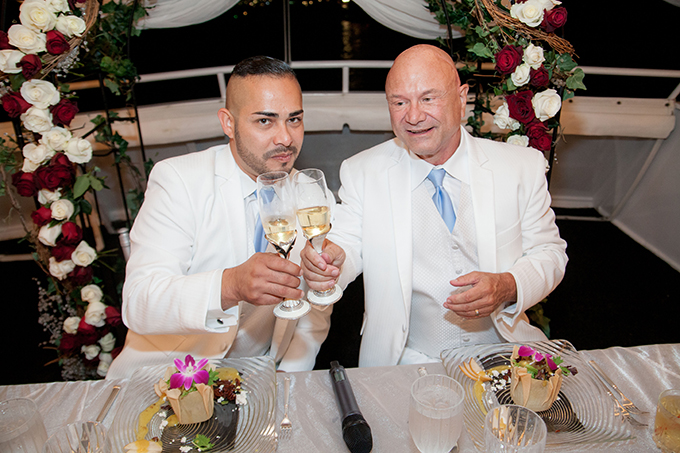 two grooms - cheers! Charter Yachts of Newport Beach