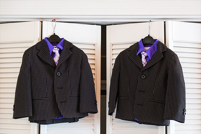Derek Chad Photography - matching pin stripe suits with radiant orchid