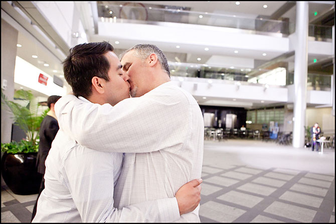 Alison Rose Photography - Candid shot of gay couple kissing