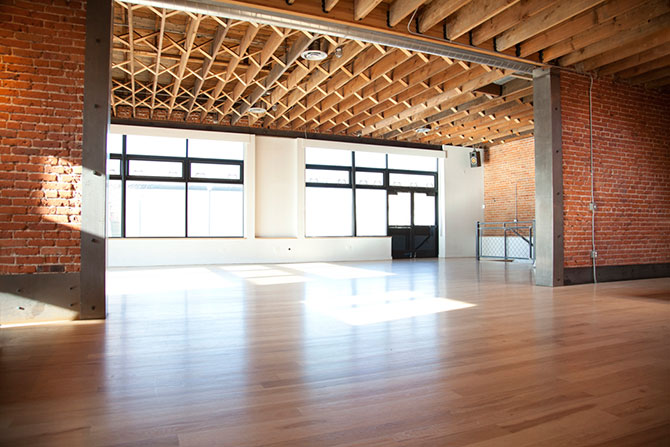 Wash Park Studio - Wood floors, brick walls and exposed ceiling