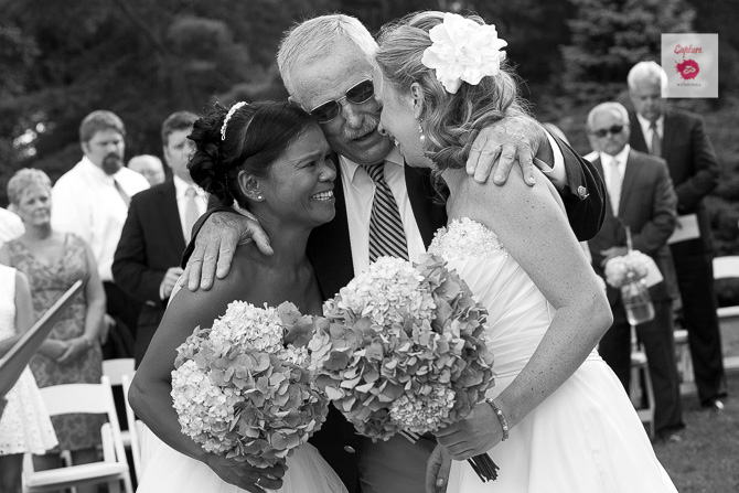 Capture Photography - Black and white photograph of brides and family