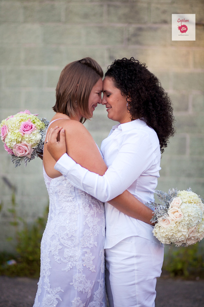Capture Photography - Candid photo of brides embracing