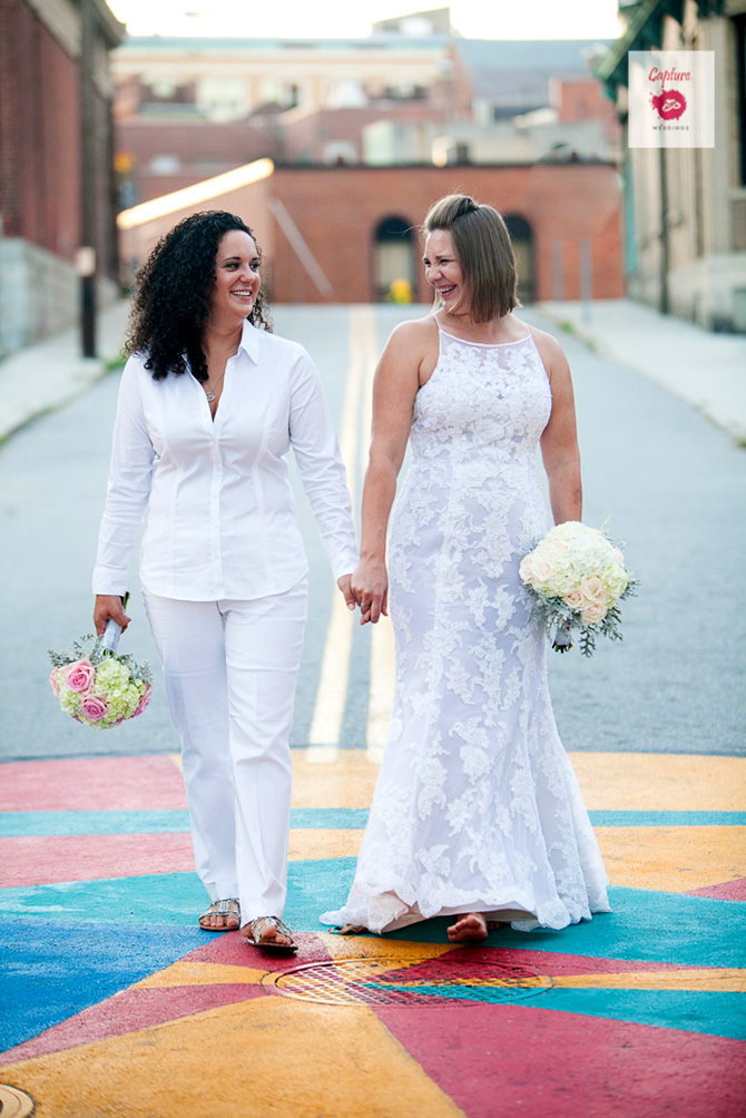 Capture Photography - Street photograph of LGBT brides with bouquets holding hands