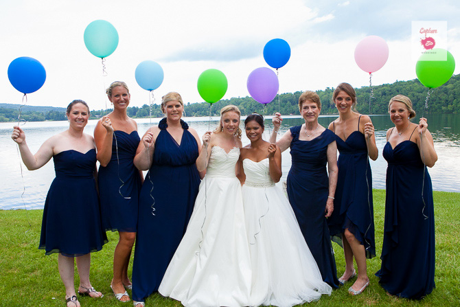 Capture Photography - Married brides with wedding party holding balloons
