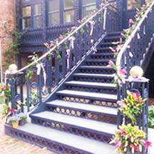 colonial wrought iron stairwell with climbing flowering vines at DACOR Bacon House