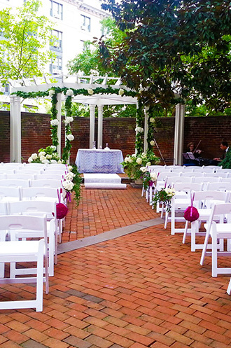 Outdoor ceremony in the colonial brock garden at DACOR Bacon House