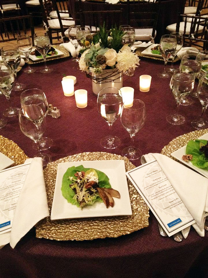 Main Event Caterers - Elegant salad, candlelit table and floral centerpiece