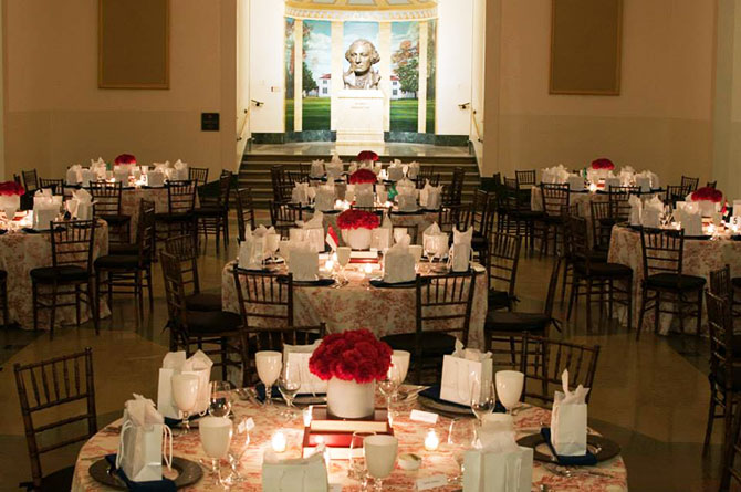 Main Event Caterers - Dining tables reception venue red floral patterns