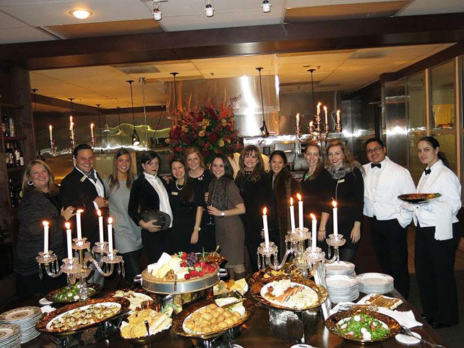 Main Event Caterers - Staff and elegant table and cuisine