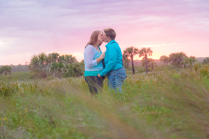 A. Harris Photography - LGBT couple kissing in a field