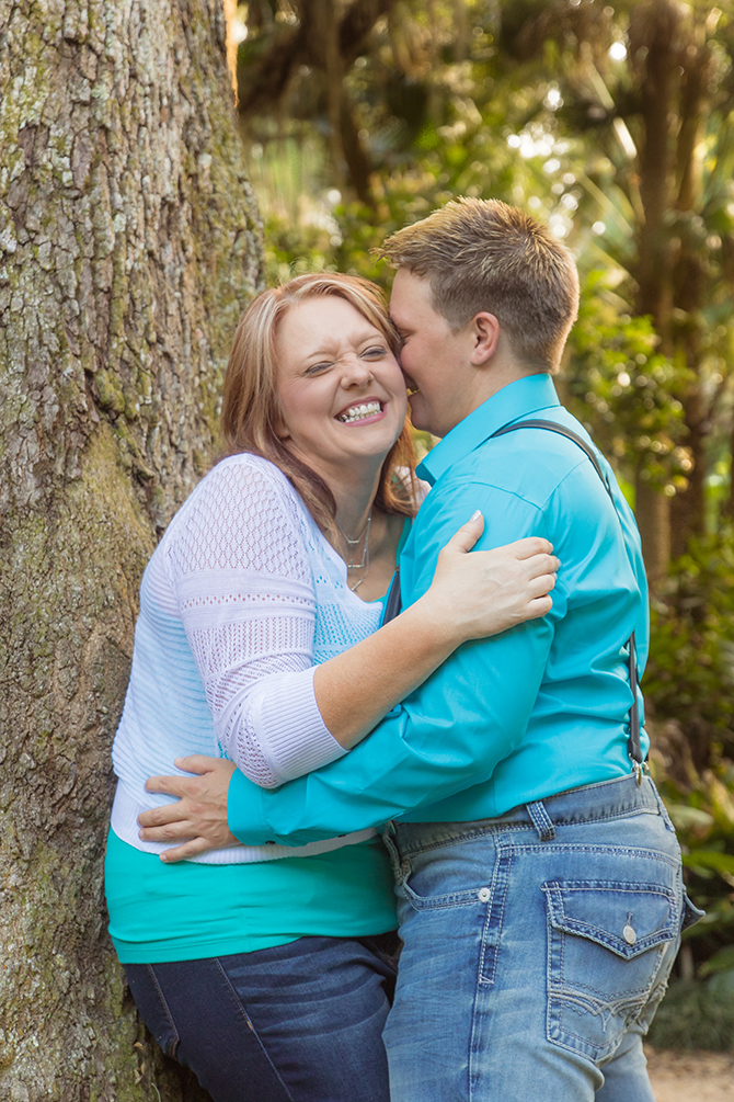A. Harris Photography - LGBT couple kissing by a tree