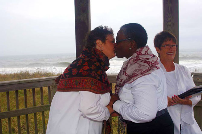 Rev. Tanya Young Venice, Florida Weddings - Brides kissing on the beach