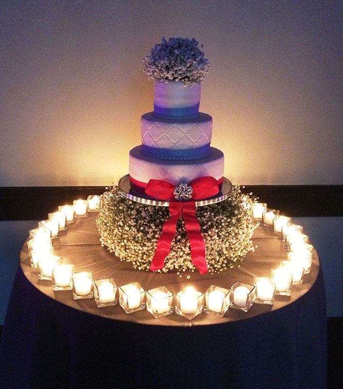 John Michael Weddings & Special Events - wedding cake with baby's breath and fondant bow