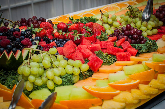 Royal Fiesta Caterers & Event Center - Fresh fruit tray strawberries, grapes, oranges, and watermelon