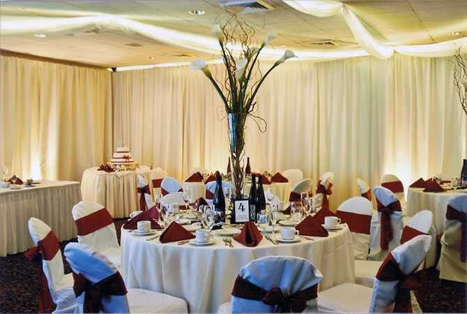 Royal Fiesta Caterers & Event Center - Formal reception seating and large lily centerpiece