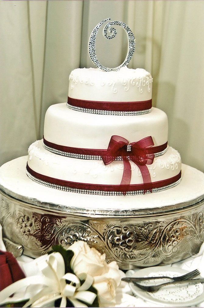 Royal Fiesta Caterers & Event Center - Custom 3-tier wedding cake maroon and white