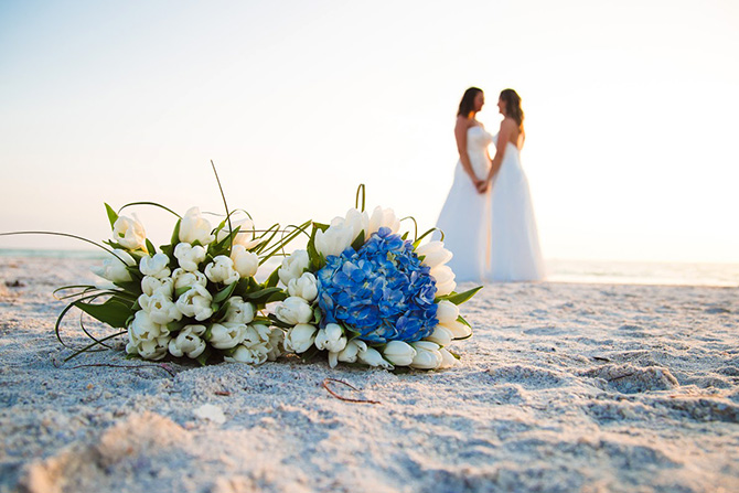 Tide the Knot Beach Weddings - Brides and bouquet on sand