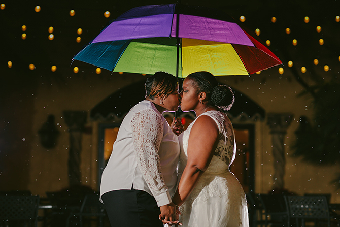 Lesbian Kiss Rainbow Umbrella - Tiny House Photo LGBT Wedding Photographer