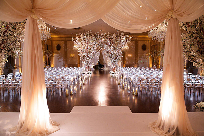 Purple orchid Wedding - Wedding ceremony venue pink drapery and lighted white orchid trees