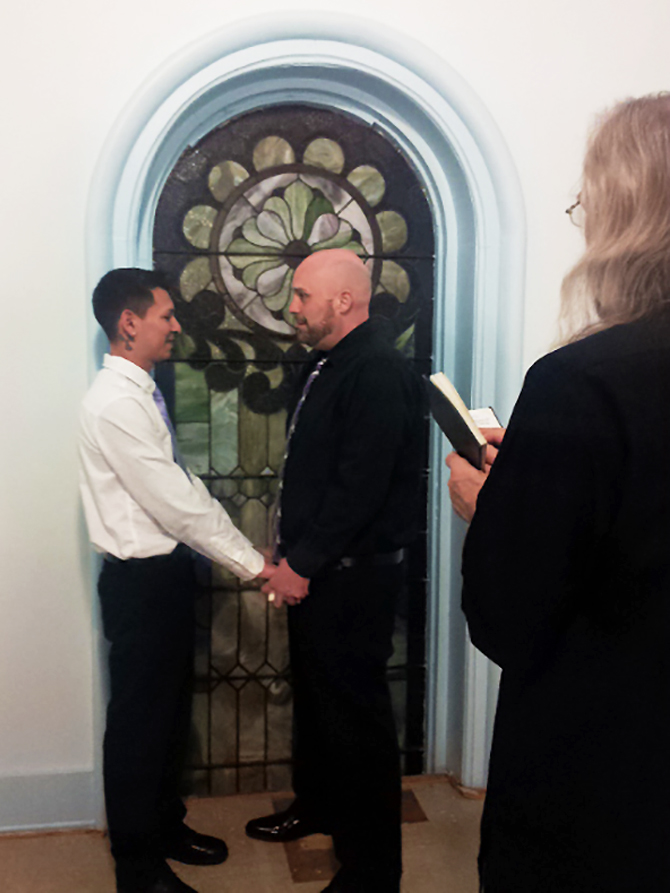 Best Wedding Chapel LGBT Shelbyville Illinois grooms inside chapel vows