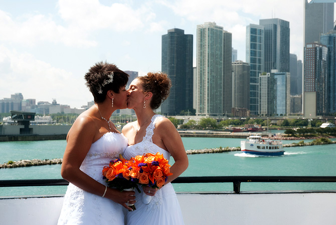 Entertainment Cruises - LGBT Brides kiss and Chicago Skyline