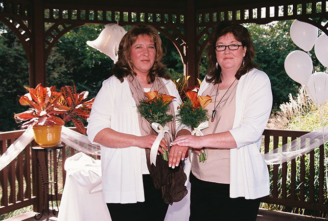 Rose LifeCycle Ceremonies - Lesbian couple at wedding alter