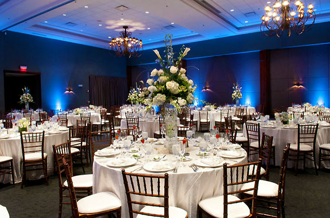 The Stonegate Conference and Banquet Centre - Reception dining table with large floral centerpiece