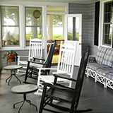 Black Walnut Point Inn - Porch and rocking chairs