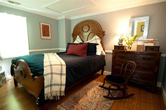 Hambleton Inn - Guestroom with walnut antique bed and chest
