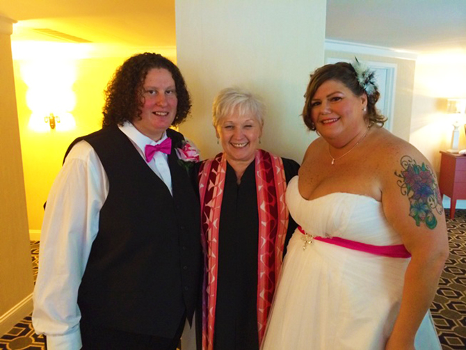 MDDC Weddings - LGBT Wedding brides with officiant