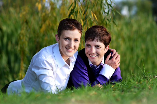 Candid shot of lesbian couple in a field - Charnell Timms Photography Maple Grove Minnesota