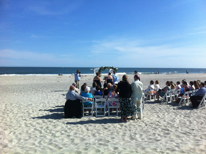 Crystal Mary Us - Wedding ceremony on the beach with guests