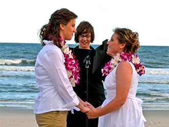 For This Joyous Occasion - Lesbian brides and beachside wedding ceremony