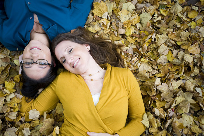same-sex couple in the leaves - Studio A Images