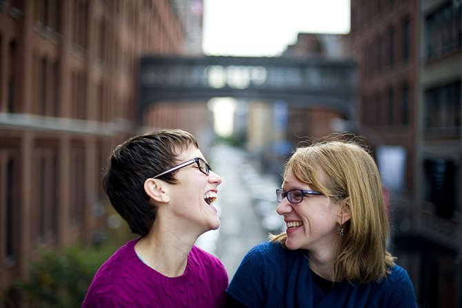 LGBT couple laughing - Studio A Images