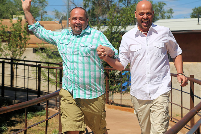Ricci Photography New Mexico - Gay couple holding hands laughing