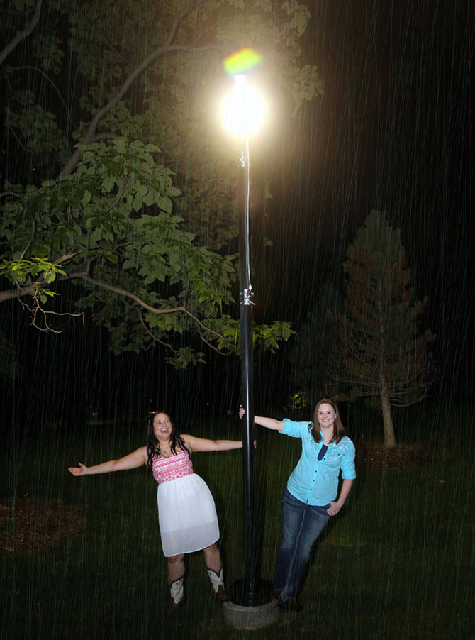 Ricci Photography New Mexico - Lesbian brides on a light pole in the rain