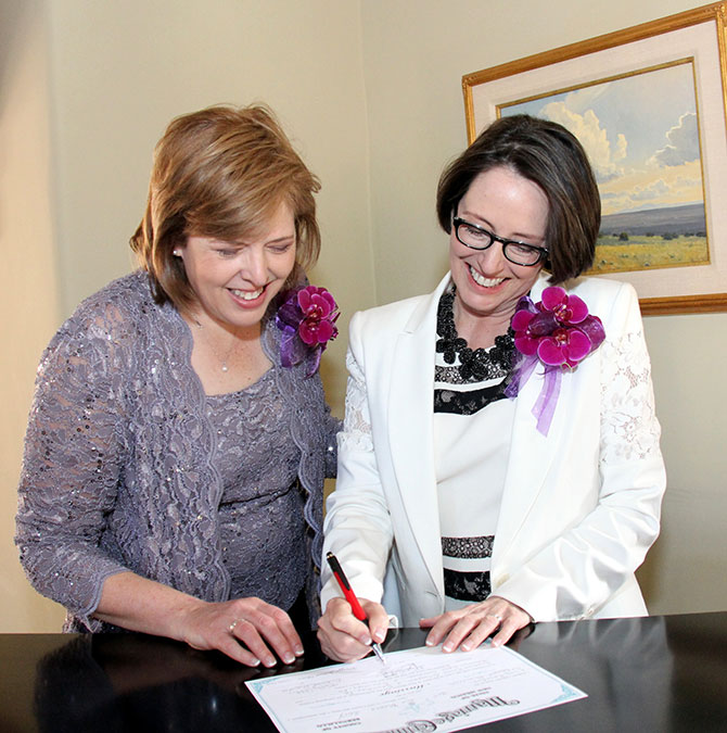 Ricci Photography New Mexico - Lesbian couple signing marriage certificate