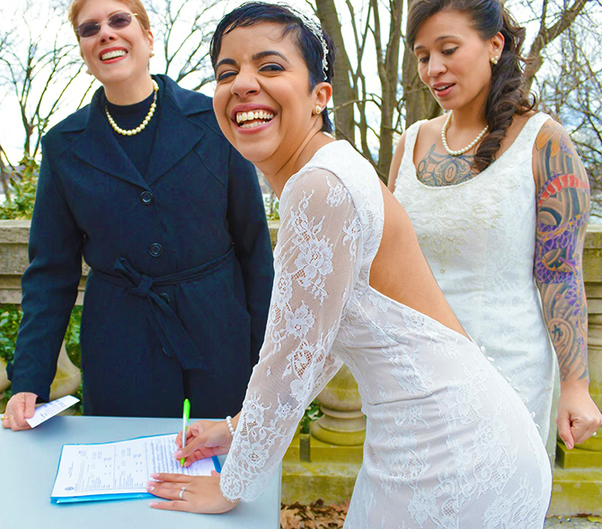 Art Of The Ceremony Manhattan New York Happy Lesbian Couple Signing Marriage Certificate
