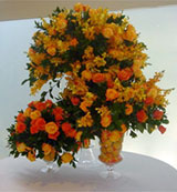 EM - Event Management - Orange and red floral arrangements