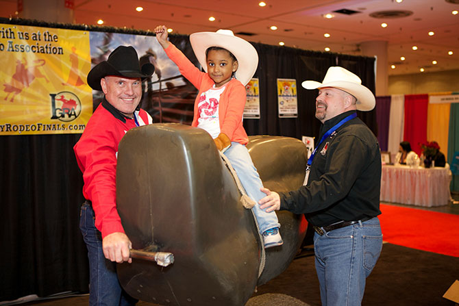 The LGBT Expo - Gay couple with daughter on mechanical bull