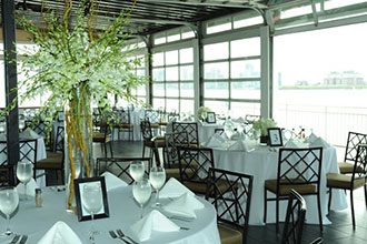 Sunset Terrace at Chelsea Piers traditional white wedding reception