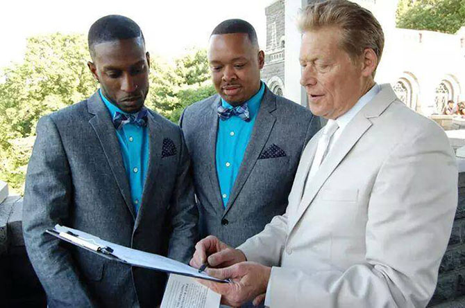 Wed in NYC - Marriage officiant explaining marriage license to gay couple
