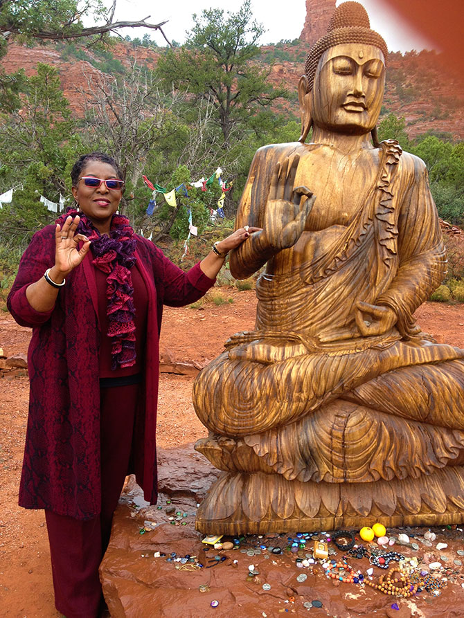 Enlightened Ceremonies - Rev. Angela Airall with Buddah Statue