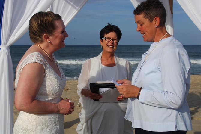 Rev. Tanya Young Outer Banks Weddings - Lesbian brides exchanging vow