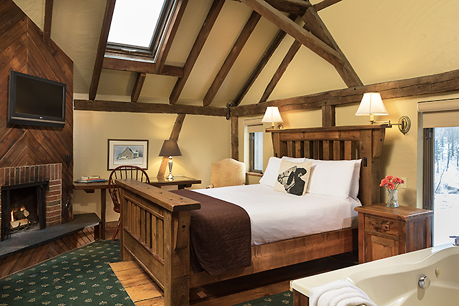 Large wood frame king bed wooden beam ceinlings at Glasbern Fogelsville, PA