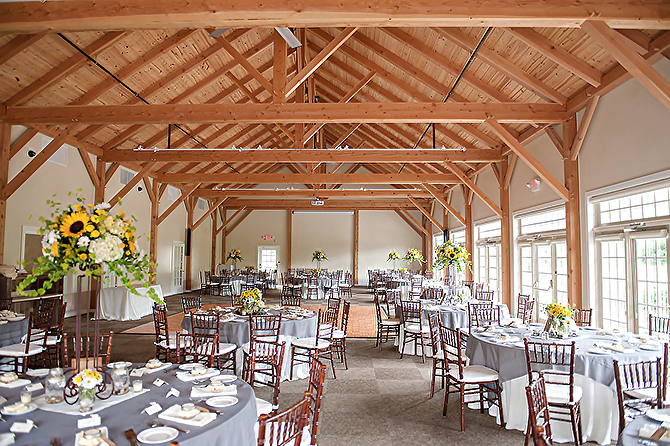 Bright reception venue in white with yellow sunflowers Glasbern Fogelsville, PA